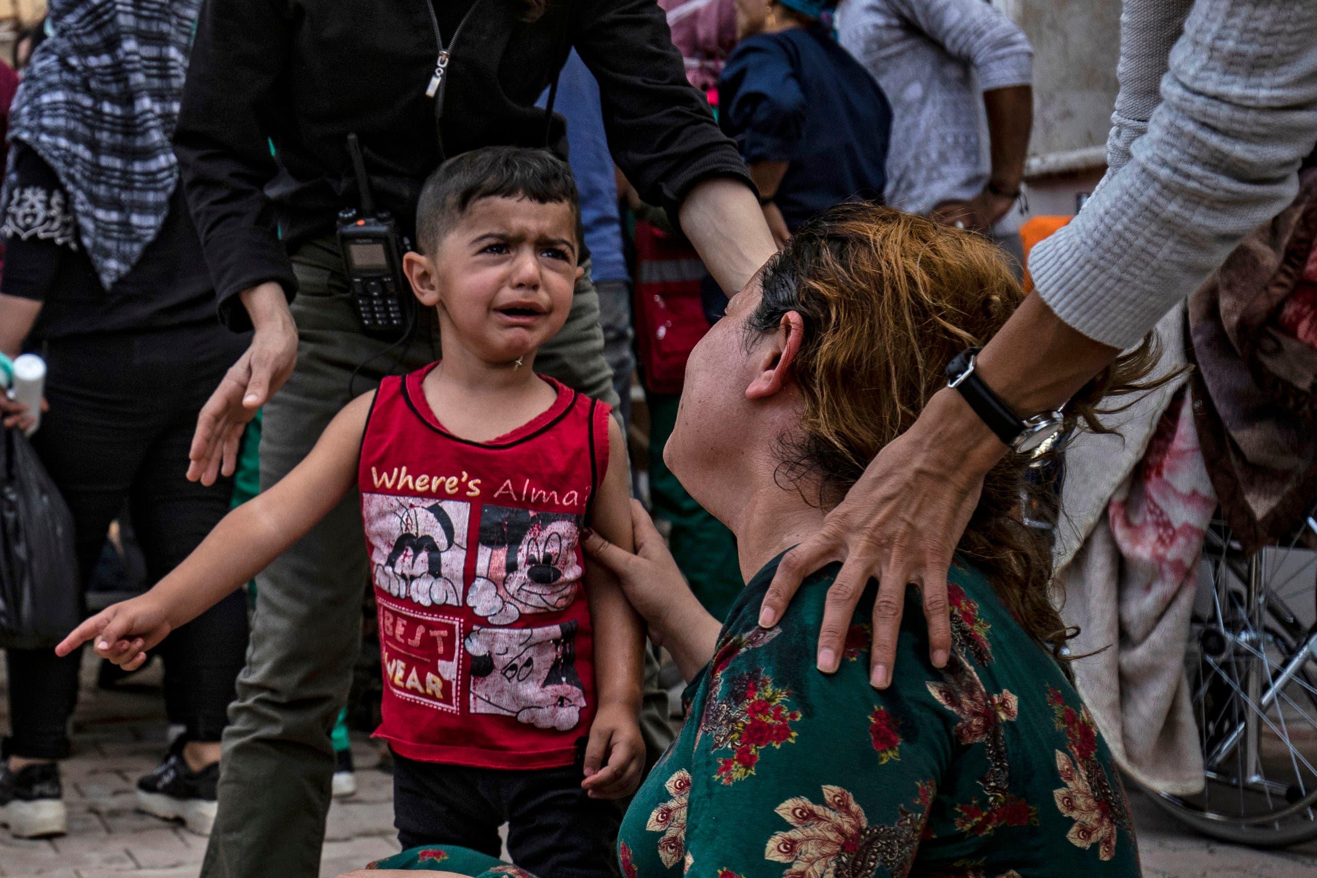 نازحون من شمال سوريا إثر العملية التركية(فرانس برس)