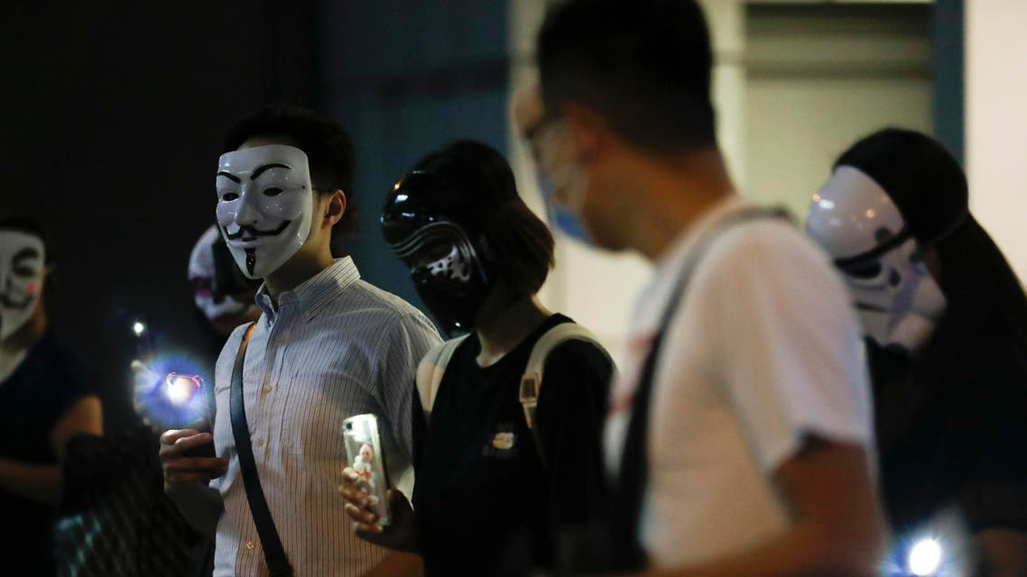 Protesters wear masks during a protest in Hong Kong, Friday, Oct. 18, 2019 (AP)
