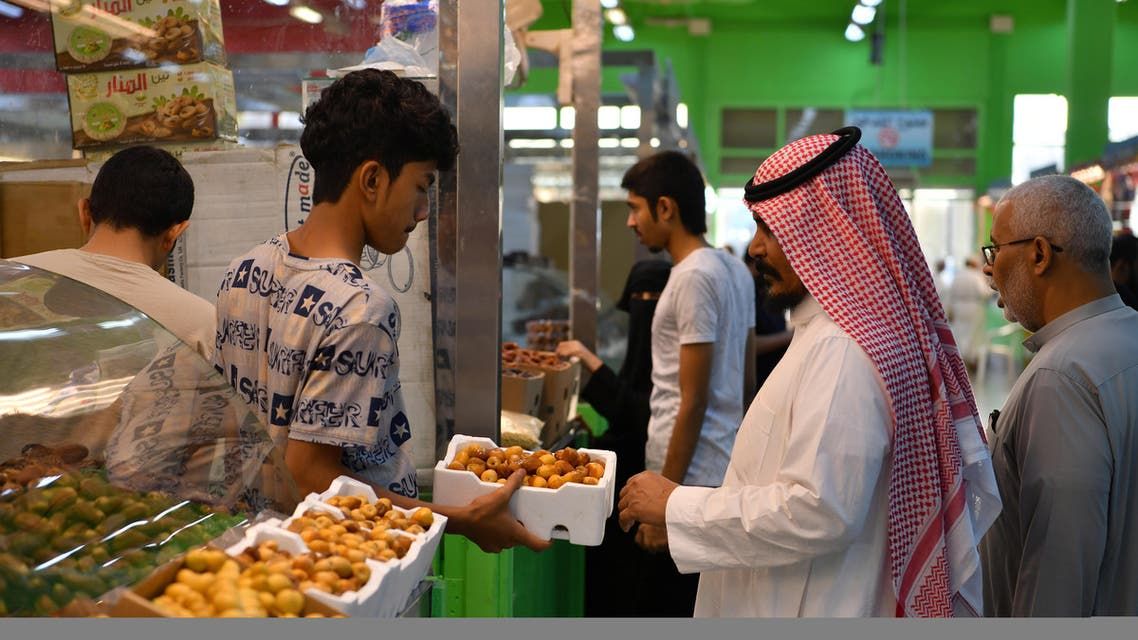 A man sells dates in a food and dates market in Mecca, Saudi Arabia, August 7, 2019. Picture taken August 7, 2019. REUTERS/Waleed Ali
