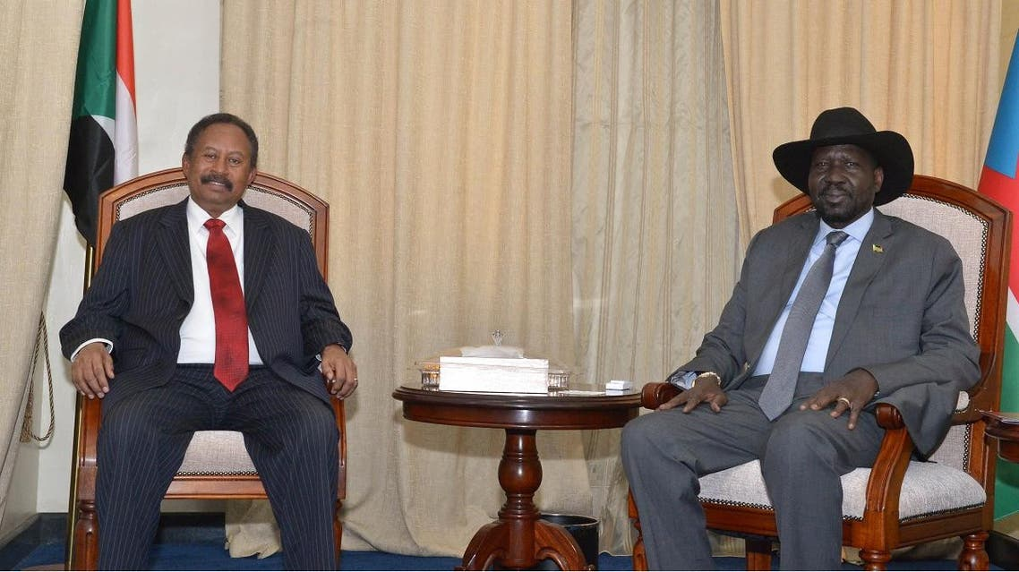Sudan's prime minister Abdalla Hamdok (L) and South Sudan's President Salva Kiir Mayardit meet on September 12, 2019 in the capital city of Juba, South Sudan. (AFP)