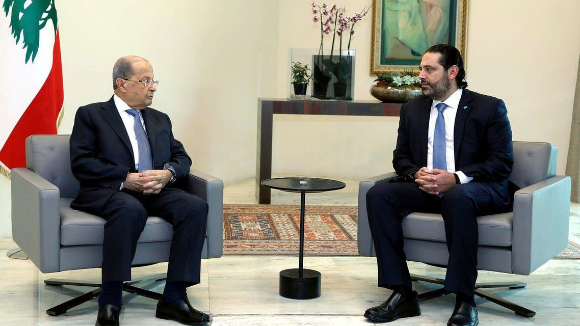 In this photo released by Lebanon's official government photographer Dalati Nohra, Lebanese President Michel Aoun, left, meets with Prime Minister Saad Hariri, ahead of a cabinet meeting, at the presidential palace, in Baabda, east of Beirut, Lebanon, Monday, Oct. 21, 2019. (AP)