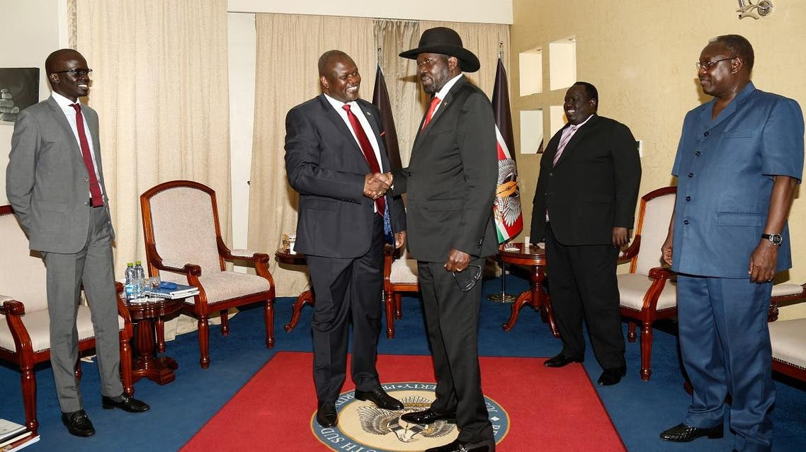 South sudan's ex-vice president and former rebel leader Riek Machar (2nd L) meets with South Sudan's President Salva Kiir (3rd R) at the presidential office in Juba, on October 19, 2019. (AFP)