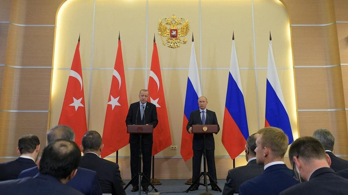Russian President Vladimir Putin (R) and his Turkish counterpart Recep Tayyip Erdogan give a joint press conference following their talks in the Black sea resort of Sochi on October 22, 2019. (AFP)