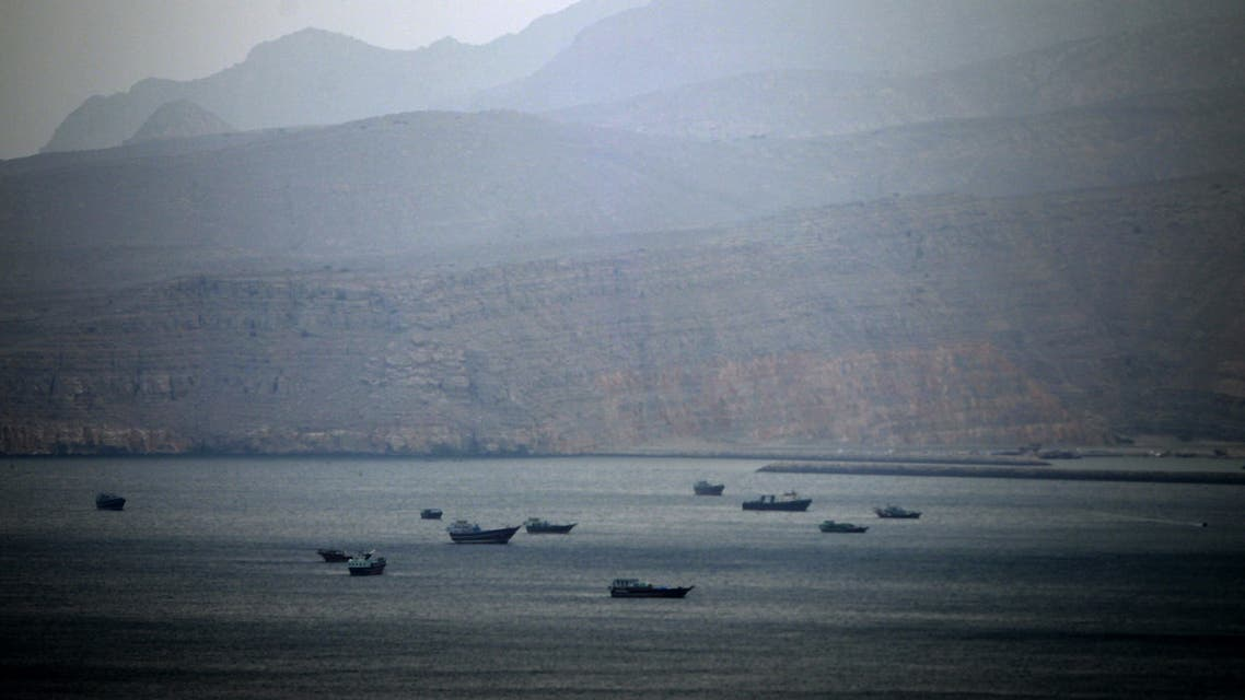 fishing boats and cargo ships are seen in the Strait of Hormuz at Khasab area of Oman on January 2012 AFP