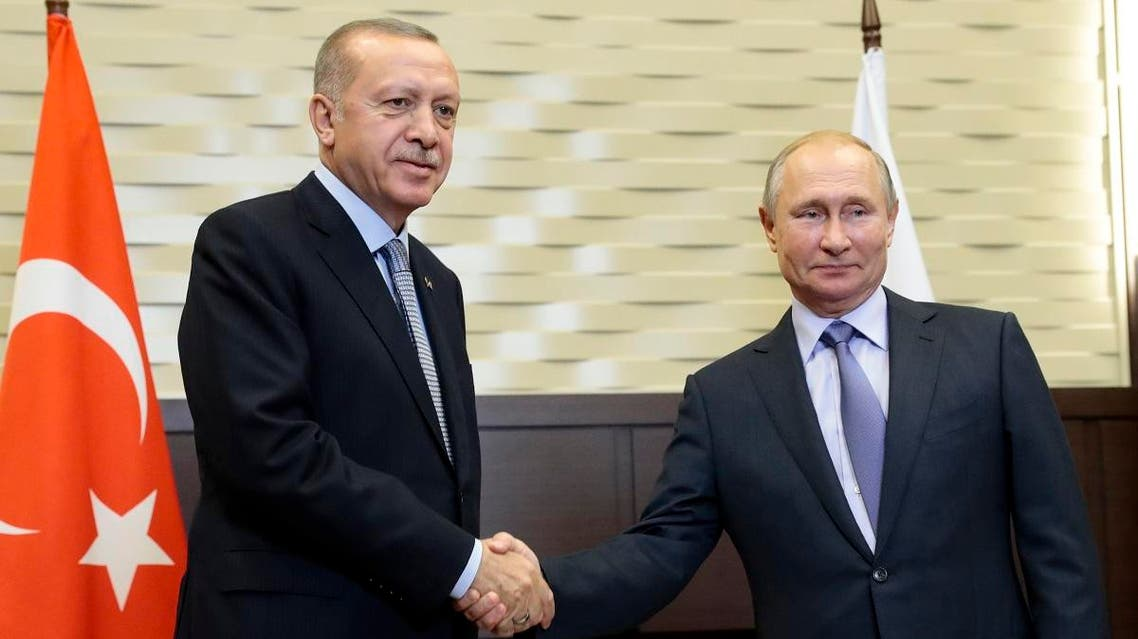Putin, right, and Turkish President Recep Tayyip Erdogan pose for a photo during their meeting in the Bocharov Ruchei residence in the Black Sea resort of Sochi, Russia, Tuesday, Oct. 22, 2019. (AP)