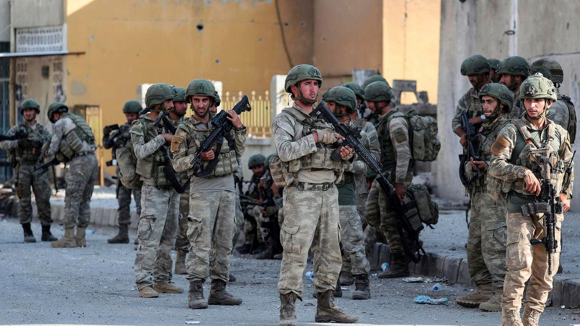 Turkish soldiers secure in Syrian town of Ras al Ayn, northeastern Syria, Wednesday, Oct. 23, 2019. (AP)