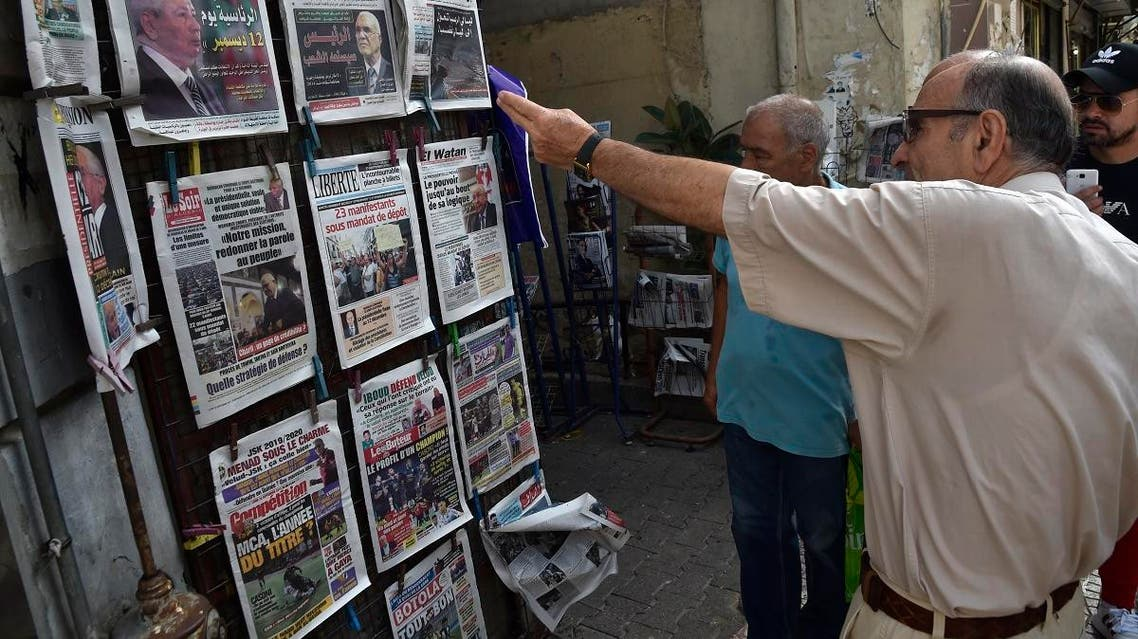 People view the covers of national and foreign newspapers, with the announced Algerian presidential election date dominating headlines, at a stand in Algeria's capital Algiers on September 16, 2019. (AFP)