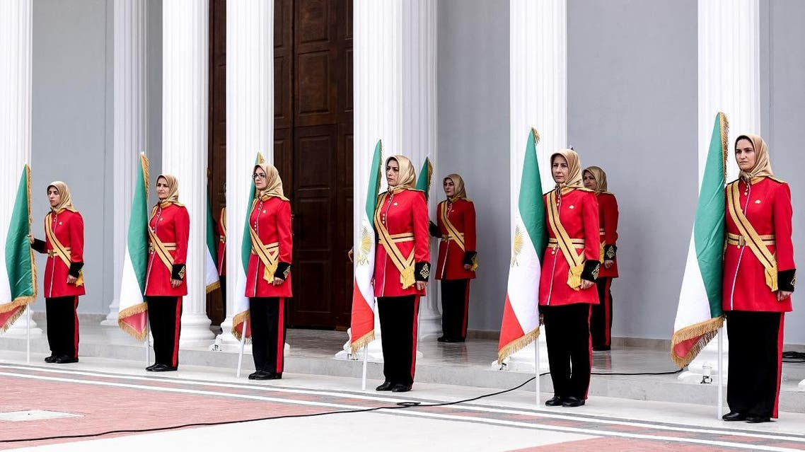 """Mujahedin-e Khalq honor guard stand guard during a welcoming ceremony for personalities taking part in the conference """"120 Years of Struggle for Freedom Iran"""" at the Ashraf-3 camp, which is a base for the People's Mojahedin Organization of Iran (MEK) in Manza, Albania, on July 12, 2019. (AFP)"""