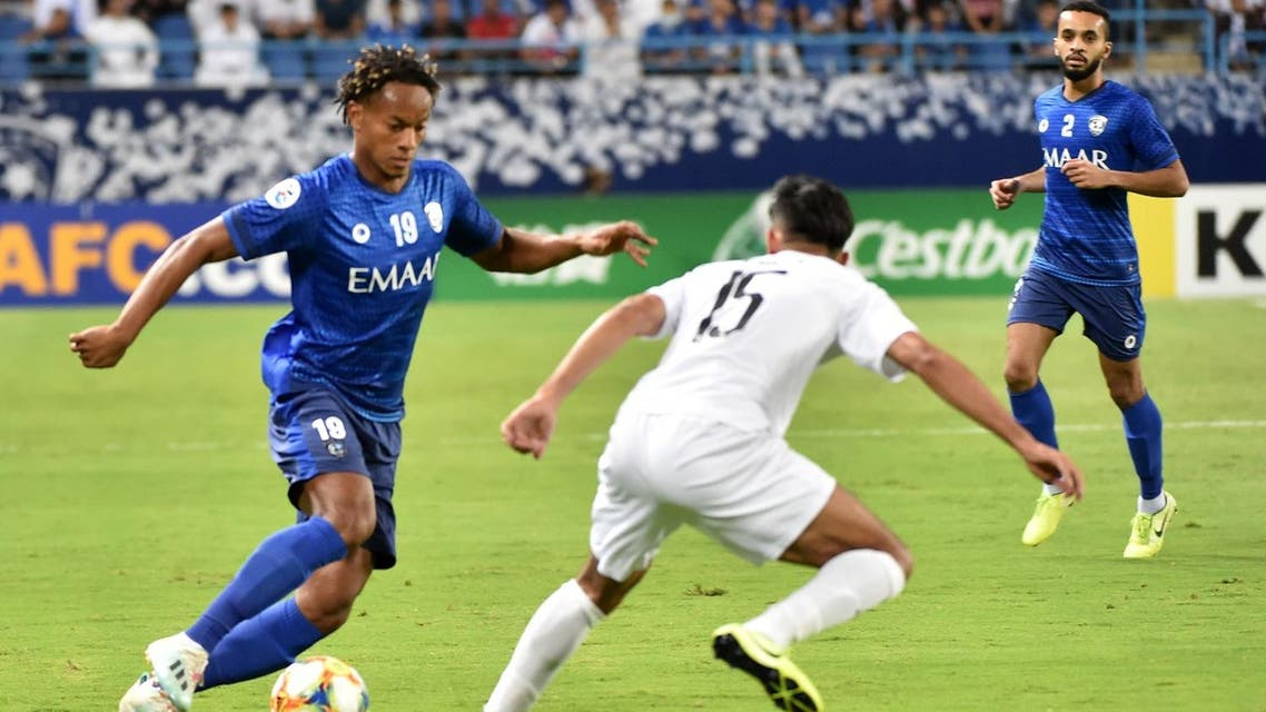 Hilal's midfielder Andre Carrillo fights for the ball with Sadd's midfielder Tarek Salman during the second leg of the AFC Champions League semi-finals football match. (AFP)