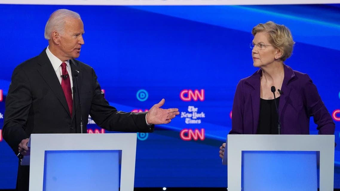 Democratic presidential candidate and former Vice President Joe Biden and Senator Elizabeth Warren speak during the fourth U.S. Democratic presidential candidates 2020 election debate in Westerville, Ohio. (Reuters)