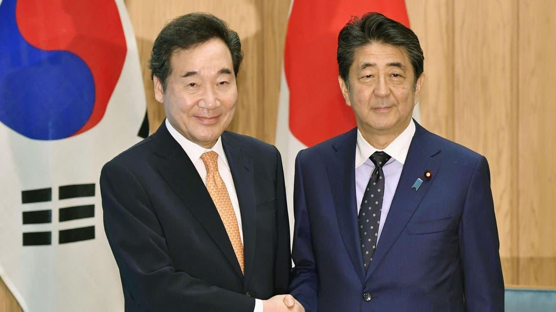 South Korea's Lee Nak-yon and Japan's Shinzo Abe meet - Reuters