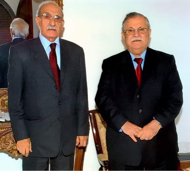 درويش مع الرئيس العراقي الأسبق جلال الطالباني