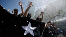 Protests rage in Chile despite president's reform promise