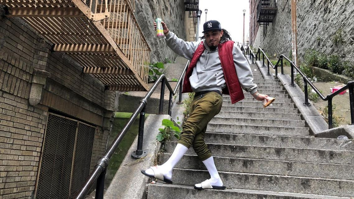 """Jay Garcia, a radio host from Queens, dances down the """"Joker Steps"""" in the Bronx. (Reuters)"""