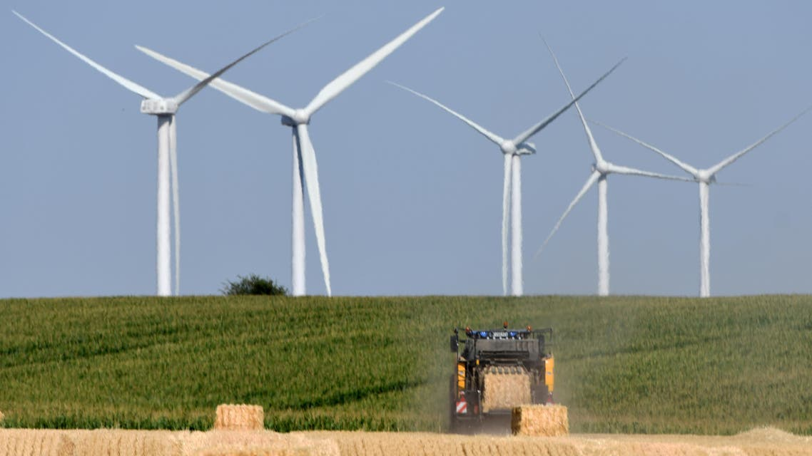 Wind turbines agriculture farming hay bales tractor Guigneville, central France - AFP