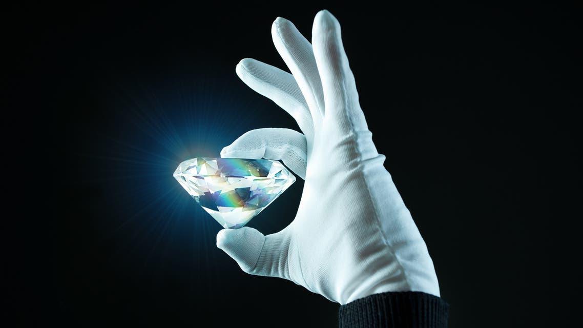 Hand wit a diamond stock photo
