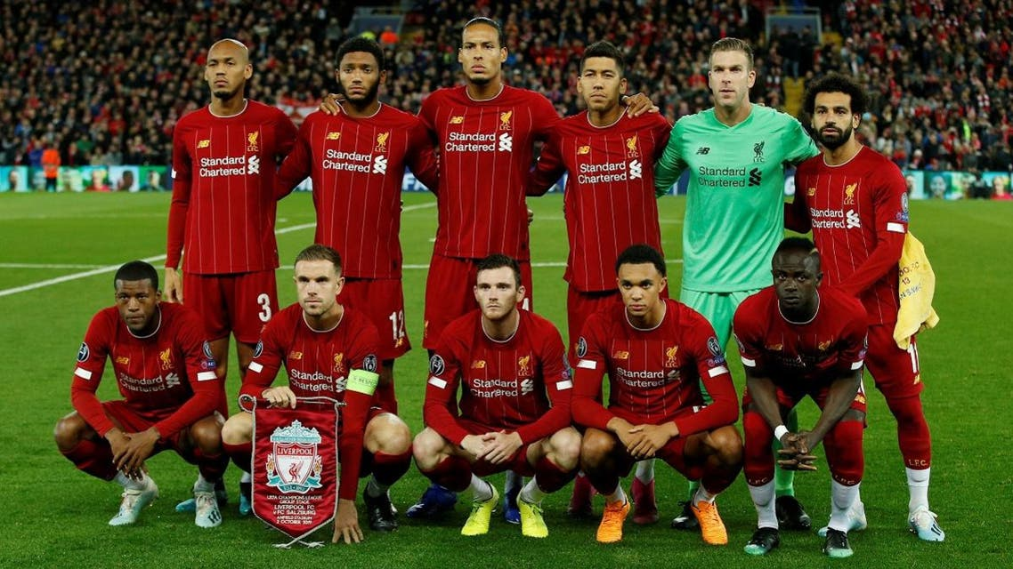 Liverpool players pose for a team group photo before a match. (AFP)