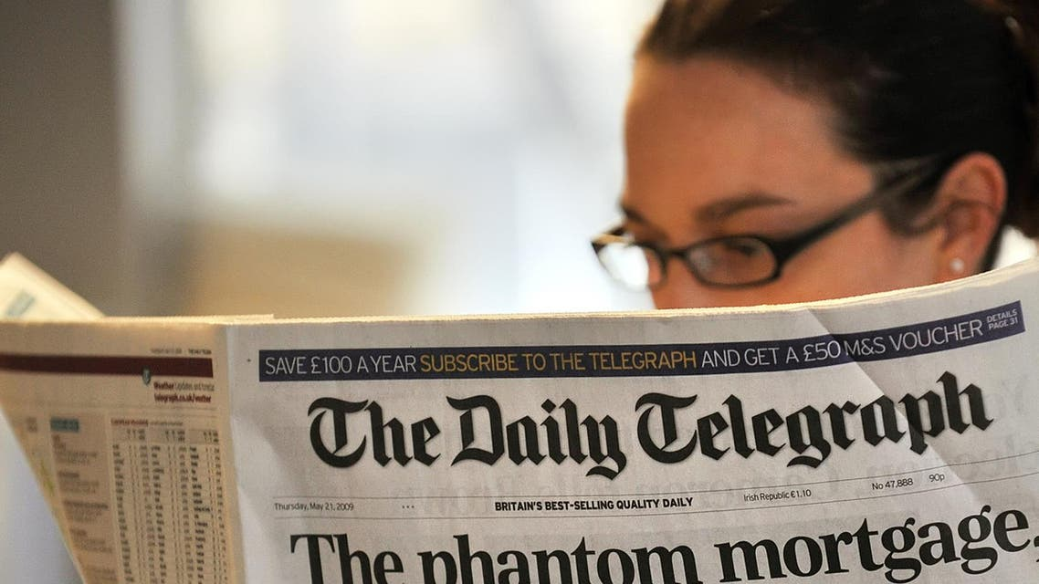A woman reads a copy of the Daily Telegraph newspaper in London, on May 21, 2009. (AFP)