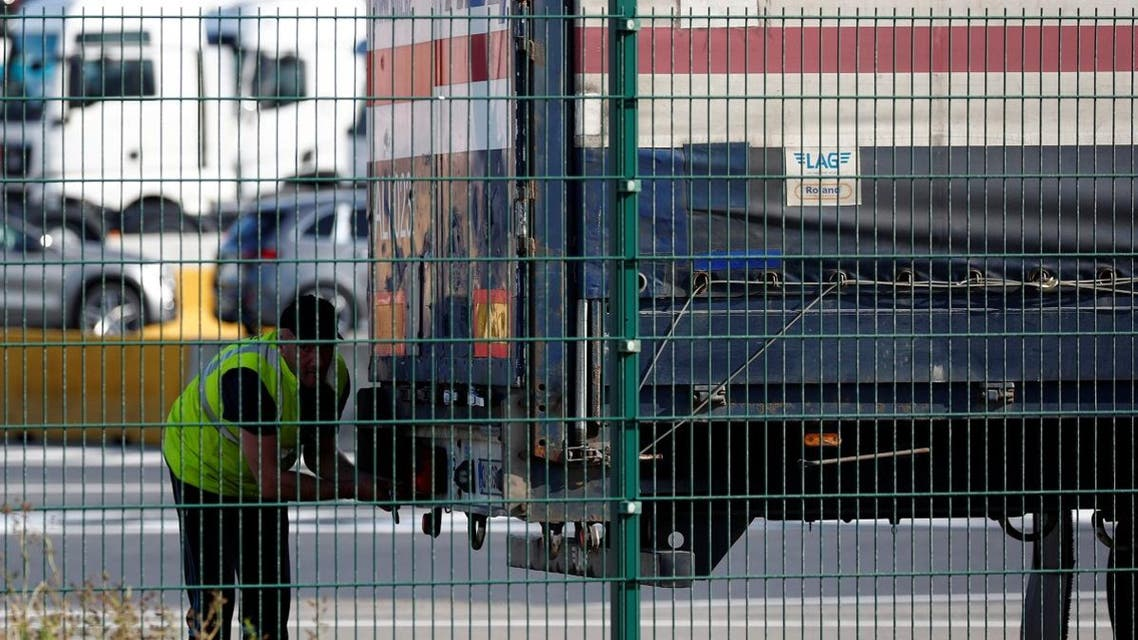 A truck driver is seen at the port of Zeebrugge after British police found bodies inside a lorry container in Grays, Essex, in Zeebrugge. (Reuters)