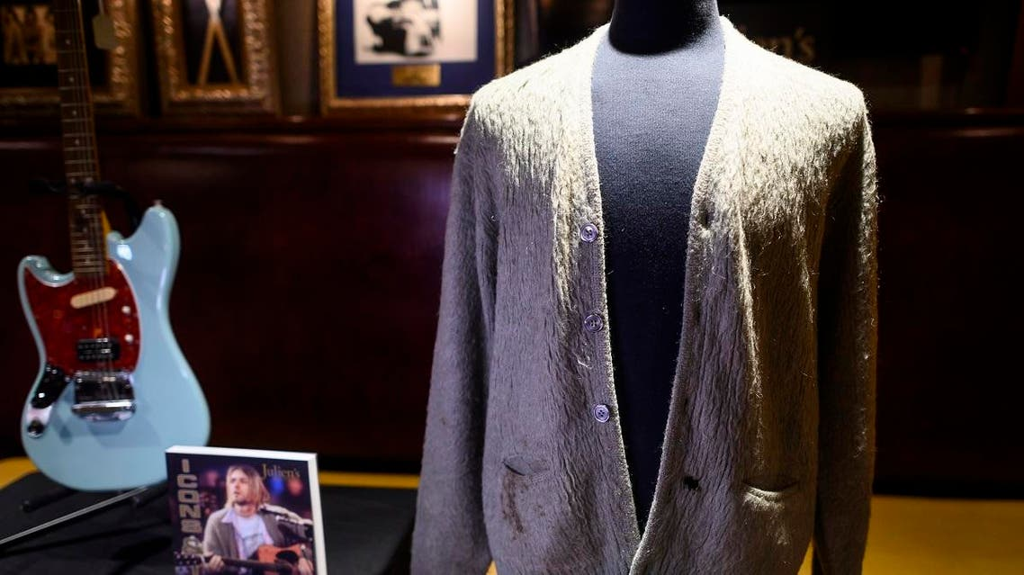 Kurt Cobain's cardigan from Nirvana's 1993 MTV Unplugged performance is on display at the Hard Rock Cafe in New York City ahead of the auction of Julien's Auctions on October 21. (AFP)