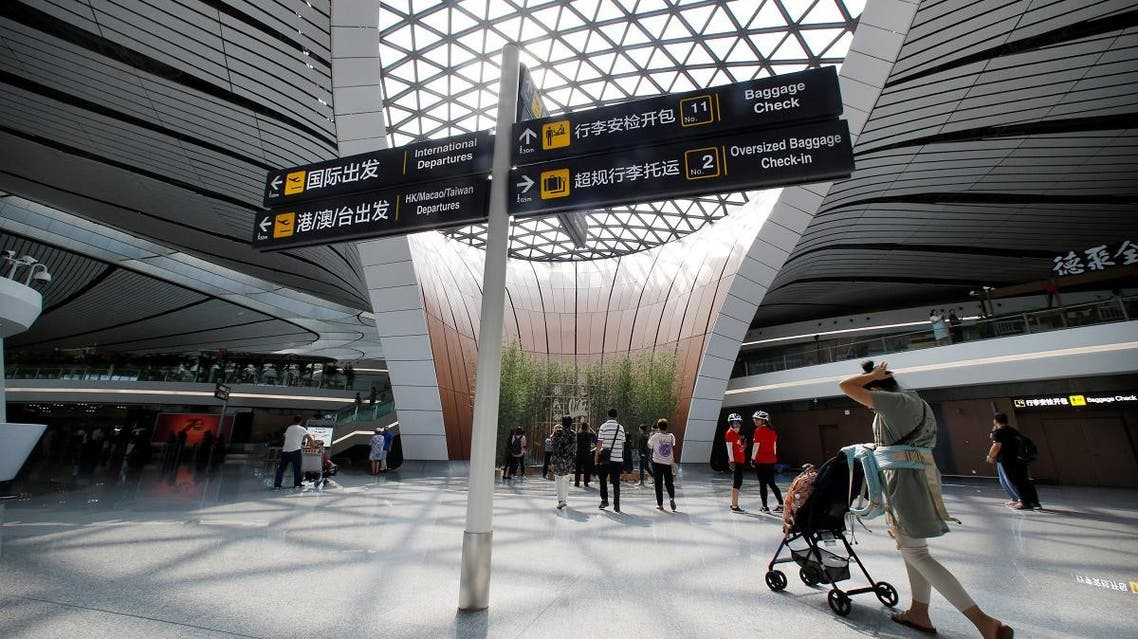 People walk at the terminal hall of the newly launched Daxing International Airport on the outskirts of Beijing. (Reuters)