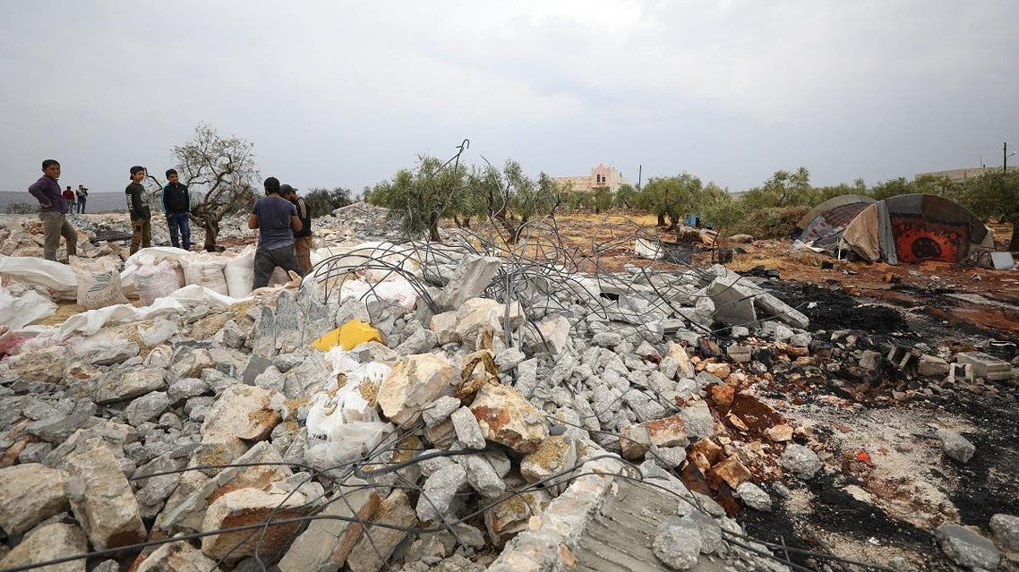 A picture taken on October 28, 2019 shows Syrians sifting through the rubble at the site of a suspected US-led raid against ISIS chief al-Baghdadi the previous day, in the Syrian village of Barisha in the country's opposition-held northwestern Idlib province. (AFP)