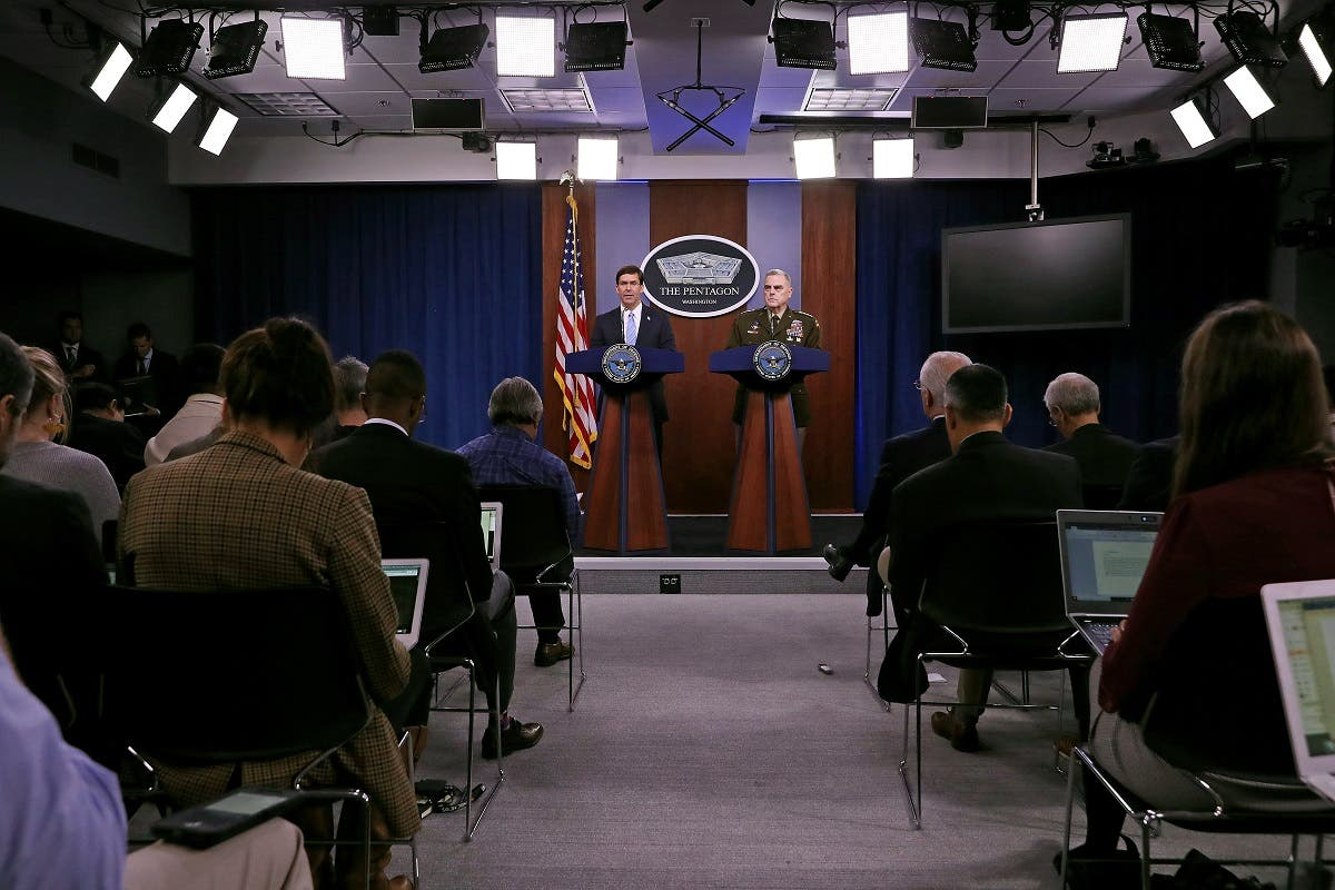 US Defense Secretary Mark Esper (L) and Chairman of the Joint Chiefs of Staff Gen. Mark Milley hold a news conference at the Pentagon the day after it was announced that Abu Bakr al-Baghdadi was killed in a US raid in Syria October 28, 2019 in Arlington, Virginia. (AFP)