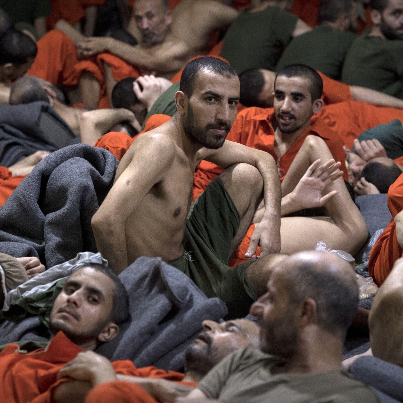 على خطى ضحاياهم.. شاهد سجناء داعش بالبرتقالي