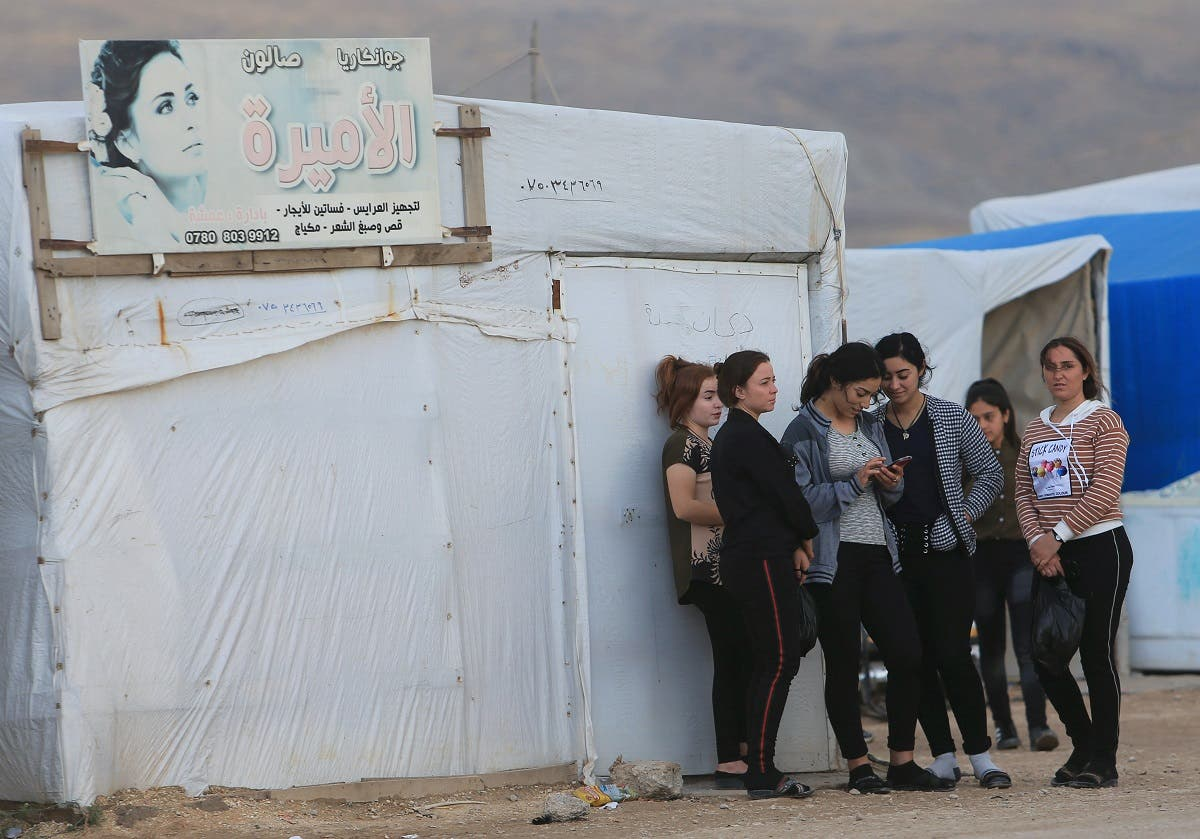 Displaced people from the Yazidi religious minority are seen at the Sharya camp, in Duhok, Iraq. (Reuters)