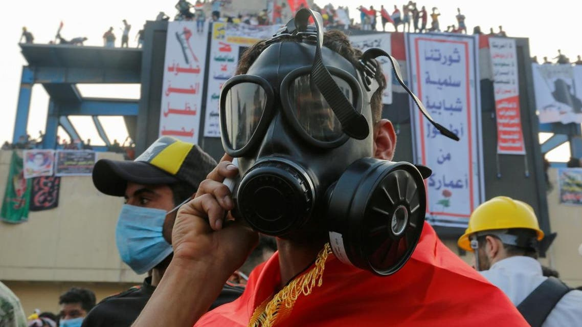 A demonstrator wears a mask to protect himself from tear gas during a protest over corruption, lack of jobs, and poor services, in Baghdad. (Reuters)