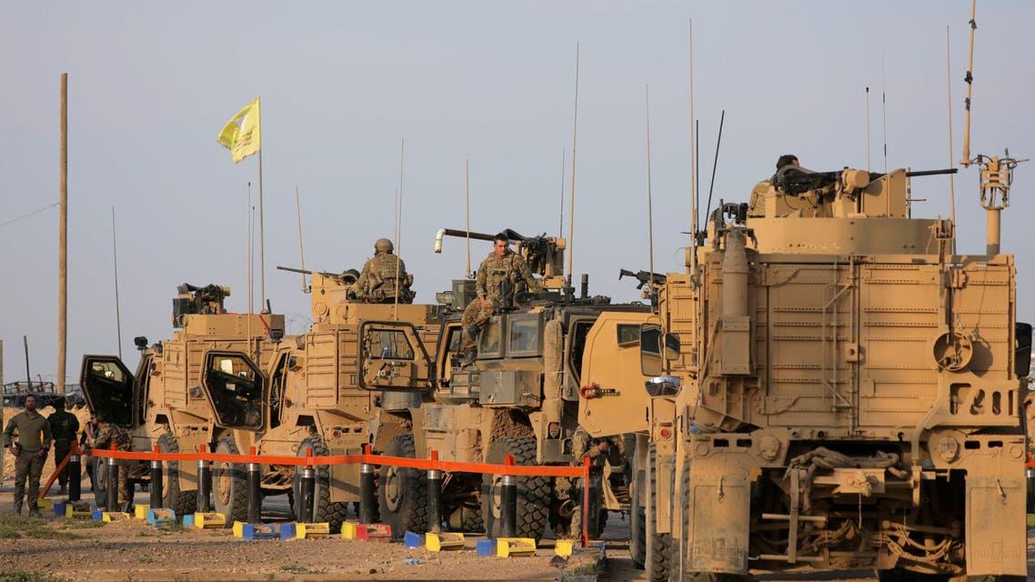 آليات عسكرية أميركية بالقرب من حقل العمر في دير الزور(أرشيفية- رويترز)