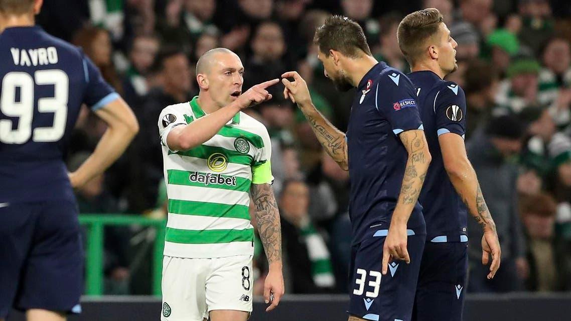 Celtic's Scott Brown (L) argues with Lazio's Francesco Acerbi during the match at Celtic Park stadium in Glasgow, Scotland, on Oct. 24, 2019. (AP)