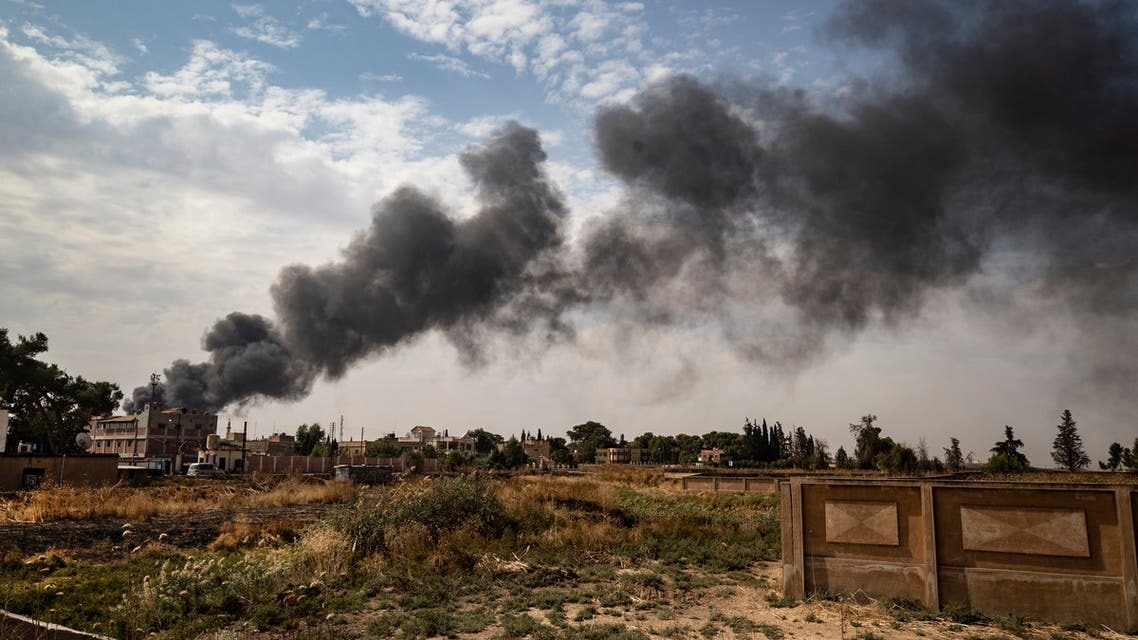 This picture taken on October 16, 2019, from the outskirts of the town of Tal Tamr near the Syrian Kurdish town of Ras al-Ain along the border with Turkey in the northeastern Hassakeh province, shows a large smoke plume from a tire fire billowing to decrease visibility for Turkish warplanes during the continuing deadly cross-border Turkish offensive against Syria's Kurdish forces that has sparked an international outcry.