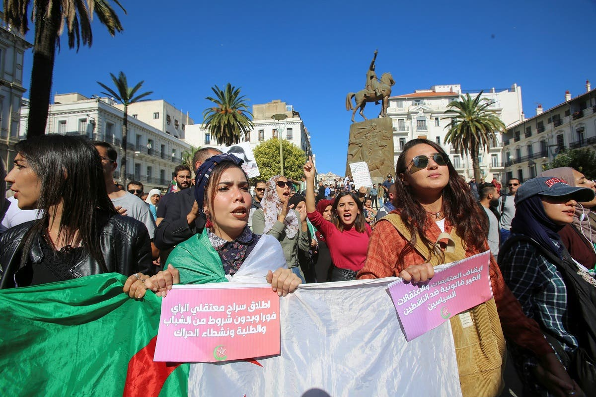 Demonstrators carry a national flag and banners during a protest against the country's ruling elite and to demand an end to corruption and the army's withdrawal from politics in Algiers, Algeria October 29, 2019. Picture taken October 29, 2019. REUTERS