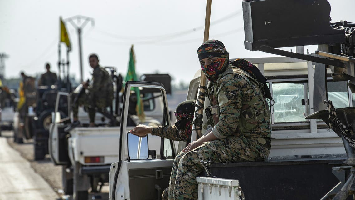Fighters from the Syrian Democratic Forces  SDF gather in their military vehicles as they withdraw from the Sanjak Saadoun border area near the northern Syrian town of Amuda on October 27 2019