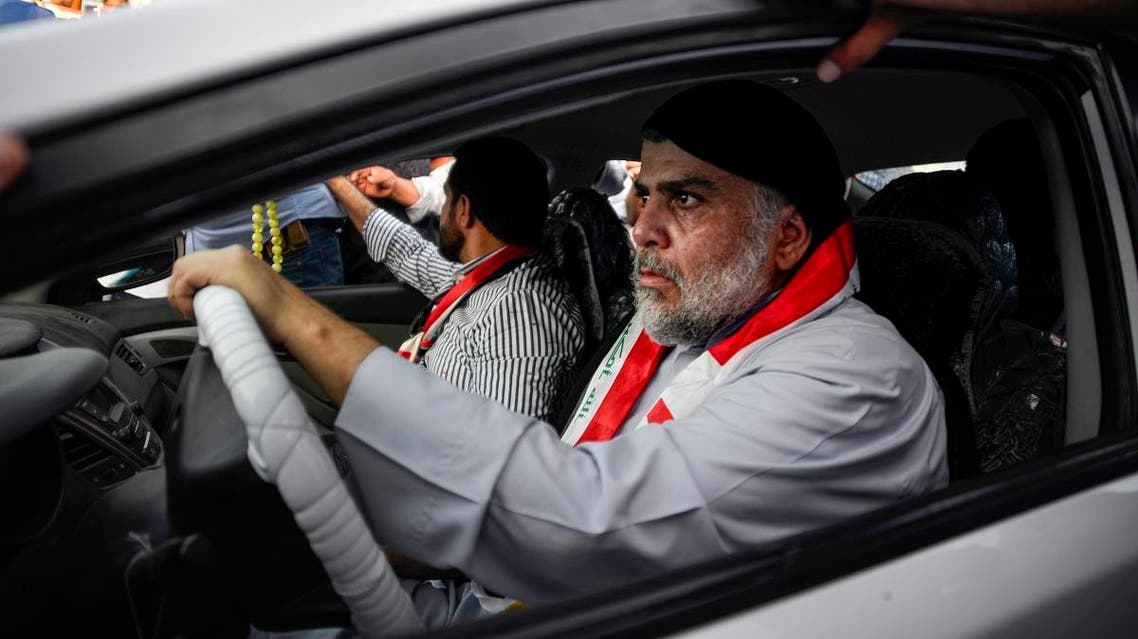 Moqtada al-Sadr (R) drives a car as he joins anti-government demonstrators gathering in the central holy city of Najaf on October 29, 2019. (AFP)