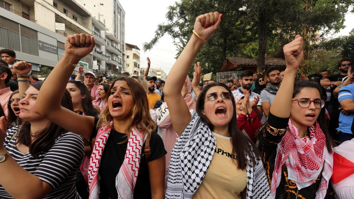 Demonstrators shout slogans during an anti-government protest in the southern city of Nabatyeh (Reuters)