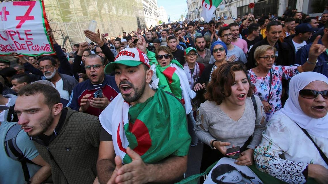 Demonstrators carry national flags and banners during a protest against the country's ruling elite and to demand an end to corruption and the army's withdrawal from politics in Algiers, Algeria October 29, 2019. Picture taken October 29, 2019. REUTERS