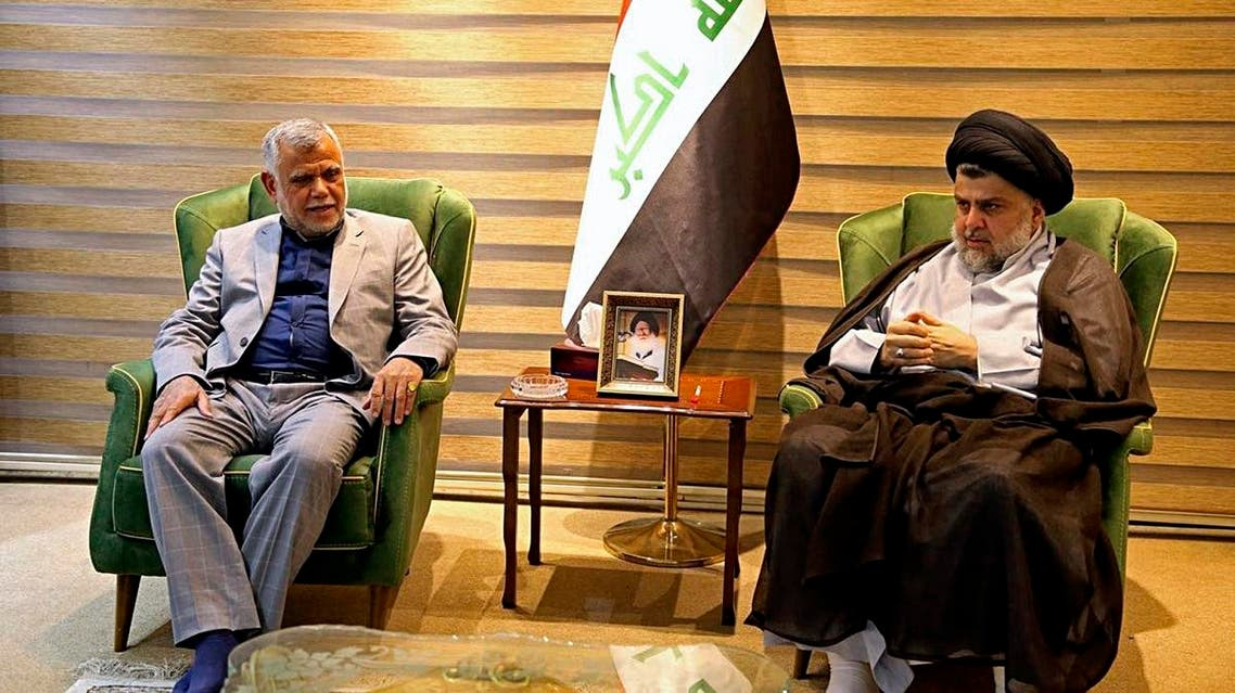 Shiite cleric Muqtada al-Sadr, right, meets with Hadi al-Amiri, commander of the Popular Mobilization Forces, in Baghdad, Iraq, early Monday, May 21, 2018. (AP)