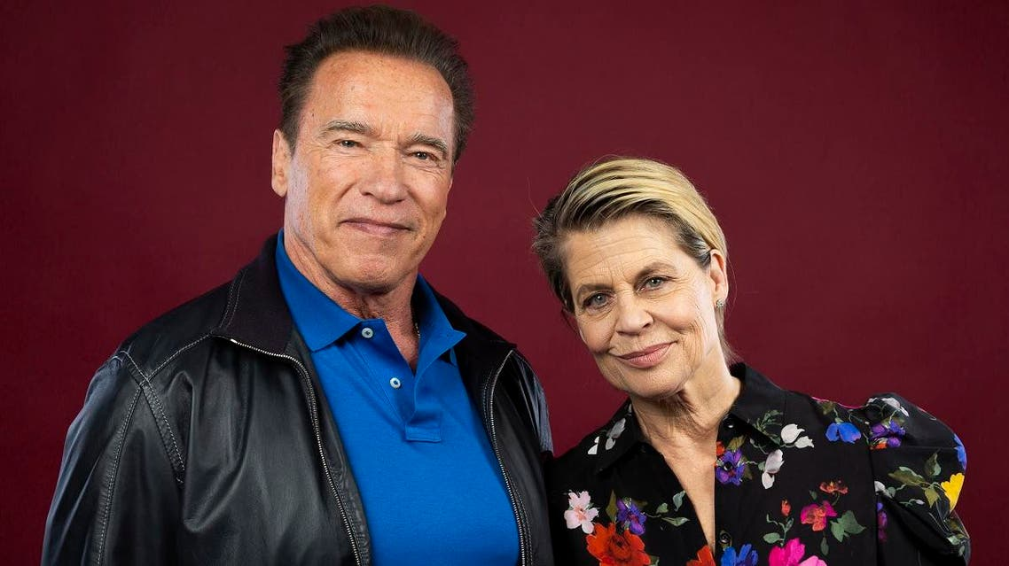 "This Oct. 26, 2019 photo shows actor Arnold Schwarzenegger, left, and actress Linda Hamilton posing for a portrait to promote the film, ""Terminator: Dark Fate"" at the Four Seasons Hotel Los Angeles at Beverly Hills in Los Angeles. (AP)"