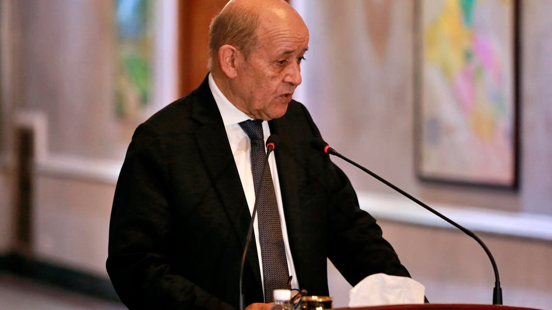 French Foreign Minister Jean-Yves Le Drian holds a press conference with Iraqi counterpart Mohamed Alhakim at the Ministry of Foreign Affairs in Baghdad, Iraq, Thursday, Oct. 17, 2019. (AP