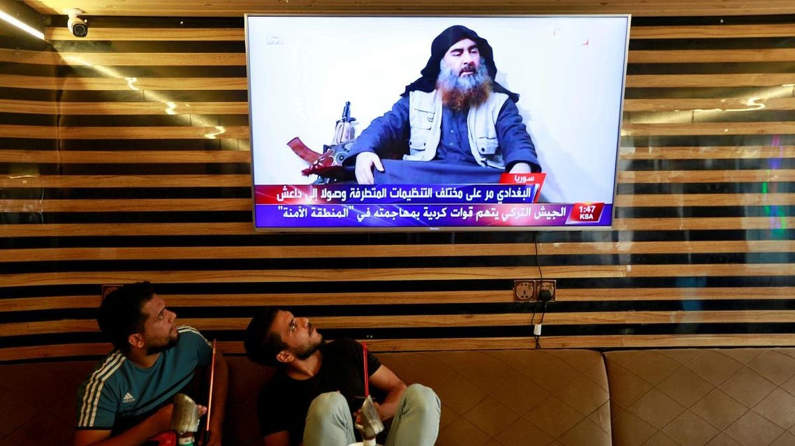 Iraqi youth watch the news of ISIS leader Abu Bakr al-Baghdadi death, in Najaf. (Reuters)