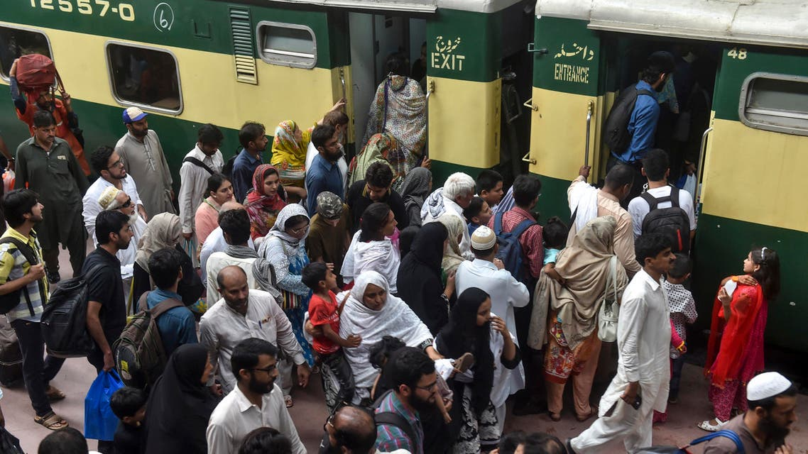 Passengers board a train during Eid in Pakistan - AFP