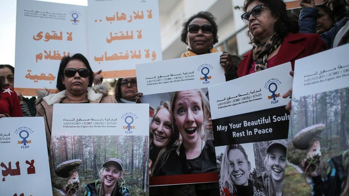 Moroccan women carry photos of 28-year-old Norwegian Maren Ueland and 24-year-old Danish Louisa Vesterager Jespersen. (AFP)
