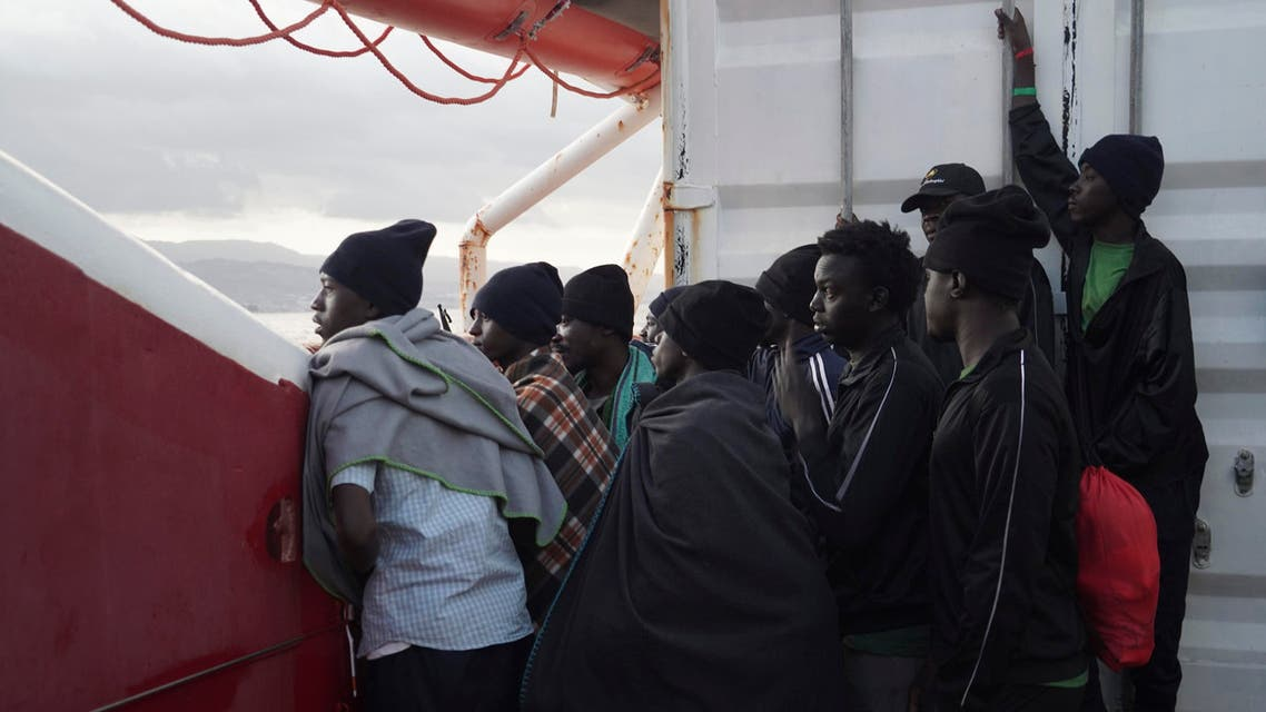 Men wait to disembark from the Ocean Viking ship as it reaches the port of Messina, Italy, Tuesday, Sept. 24, 2019. The humanitarian ship has docked in Italy to disembark 182 men, women and children rescued in the Mediterranean Sea after fleeing Libya. (AP Photo
