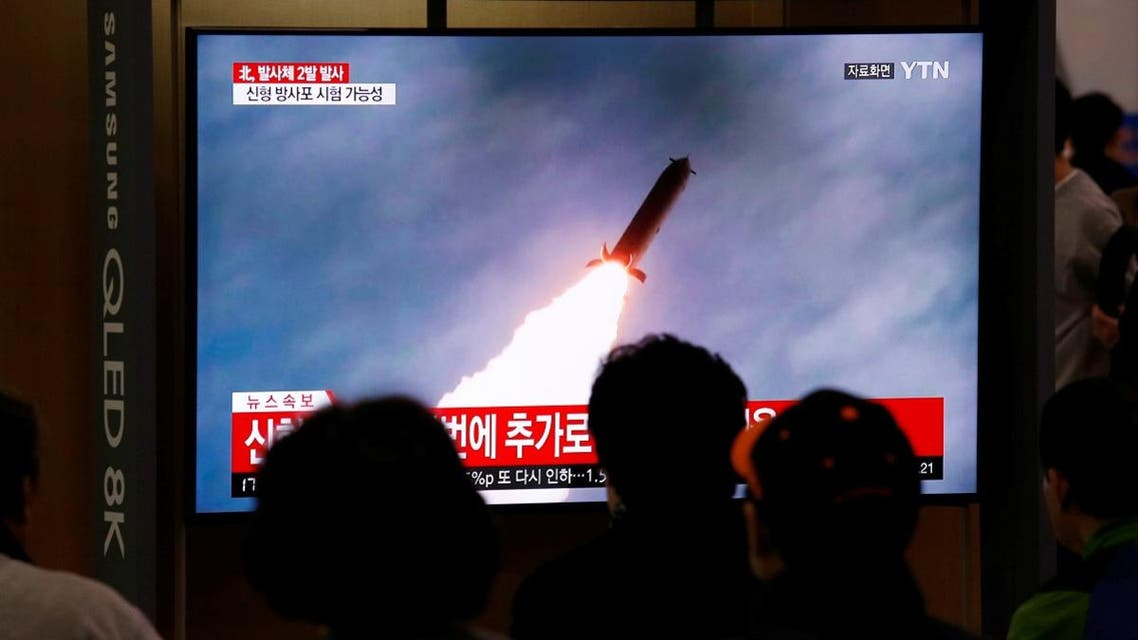 People watch a TV broadcast showing a file footage for a news report on North Korea firing two projectiles, possibly missiles, into the sea, in Seoul. (Reuters)