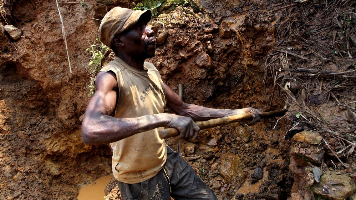 a Congolese miner digs for cassiterite, the major ore of tin, at Nyabibwe mine, in eastern Democratic Republic of Congo. (AP)