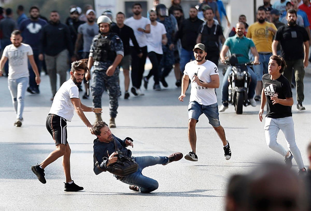 A French photographer is attacked by Hezbollah supporters while covering clashes between them and anti-government protesters, in Beirut, Lebanon, Tuesday, Oct. 29, 2019. (AP)