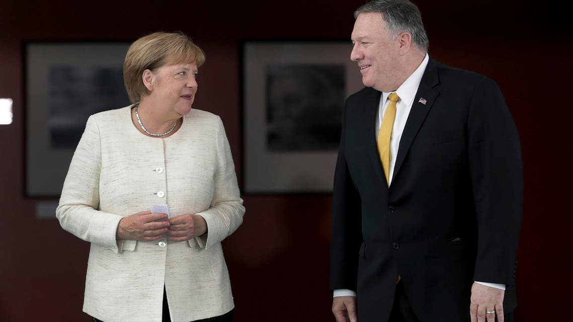 German Chancellor Angela Merkel, left, and U.S. Secretary of State, Mike Pompeo, right, talk as they arrive for a joint statement prior to a meeting at the chancellery in Berlin, Germany, Friday, May 31, 2019. (AP Photo)