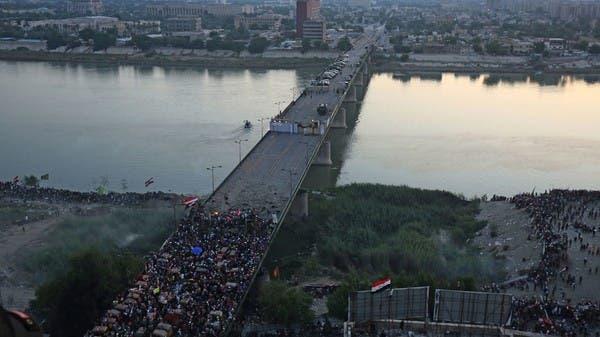 شاهد.. منتم للعصائب يهدد متظاهري العراق بجسر من الدم